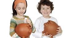 Two kids with savings (Photos.com)