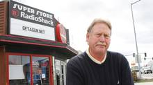 Steve Strand, who has owned the Radio Shack in Hamilton, Mont. for seven years, sits in front of his storeMarch 29, 2011 (David Erickson/David Erickson/The Associated Press)