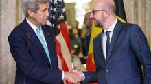 U.S. Secretary of State John Kerry shakes hands with Belgian Prime Minister Charles Michel after delivering a joint statement at the Belgian Prime Minister's Residence in Brussels, Belgium, Friday, March 25, 2016. (Andrew Harnik/REUTERS)