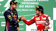 Ferrari F1 driver Fernando Alonso (R) and Red Bull's Sebastian Vettel congratulate each other on the podium after the Brazilian F1 Grand Prix at the Interlagos circuit in Sao Paulo November 24, 2013. (NACHO DOCE/REUTERS)