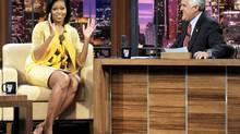 Jay Leno chats with Michelle Obama, wife of U.S. President Barack Obama. (Kevork Djansezian/Kevork Djansezian/The Associated Press)