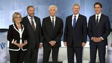 Green Party Leader Elizabeth May, NDP Leader Tom Mulcair, Bloc Quebecois Leader Gilles Duceppe, Conservative Leader Stephen Harper, and Liberal Leader Justin Trudeau pose before the French-language leaders' debate in Montreal Sept. 24, 2015. (POOL/REUTERS)