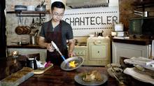 Jonathan Poon, chef and co-owner of Chantecler restaurant in Toronto, prepares seared and torched makerel with celeriac, apple and rhubarb remoulade and rye crisp (Della Rollins for The Globe and Mail/Della Rollins for The Globe and Mail)