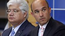 Research In Motion co-CEO Jim Balsillie, right, and president and co-CEO Mike Lazaridis listen during the annual general meeting of shareholders in Waterloo, Ont., on July 14, 2009. (MIKE CASSESE)