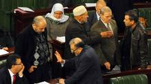 In this photo dated Jan. 23, 2014, members of the Constitutional Assembly attend a session as part of the debates on the new constitution in Tunis, Tunisia. (Hassene Dridi/AP)