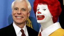 "As president and chief operating officer of McDonald's Corp., Mike Roberts, left, poses with McDonald's character ""Ronald McDonald"" during a media event for the 2005 World Children's Day'at the Ronald McDonald House in Los Angeles, Nov. 15, 2005. (FRED PROUSER/REUTERS)"