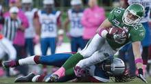 Montreal Alouettes defensive back Jerald Brown takes down the ball carrier Saskatchewan Roughriders slotback Chris Getzlaf during the second half of CFL football action in Regina, Sask., Saturday, October 20, 2012. The Alouettes defeated the Roughriders 34-28. (Liam Richards/THE CANADIAN PRESS)