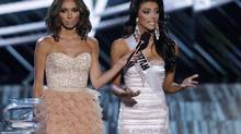 Show co-host Giuliana Rancic holds the microphone for Miss Utah Marissa Powell as she competes in the question portion during the Miss USA pageant at the Planet Hollywood Resort & Casino in Las Vegas. (STEVE MARCUS/REUTERS)