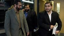 Abdullah Almalki (right), Muayyed Nureddin and Ahmad El Maati arrive at a news conference in Ottawa on Oct. 21, 2008. (Adrian Wyld/The Canadian Press)