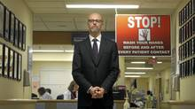 Michael Gardam, medical director of infection prevention and control at the University Health Network (specifically Safer Healthcare Now, New Approach to Controlling Superbugs) is photographed on the general surgery ward at the Toronto General Hospital on January 10 2011. As visitors to the general surgery ward get off the elevators, they immediately see this warning sign about hand washing before and after visits. (Fred Lum/The Globe and Mail/Fred Lum/The Globe and Mail)