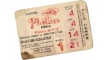 The ticket to Game 1 of the 1964 World Series that sits in the author's my desk drawer - an upper-stand reserved seat at Connie Mack Stadium, Section 4, row 14 (price: $8).