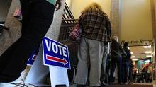 Lines begin to form in the early evening as closing time for the polls near at the Boulder County Clerk and Recorder's office during the U.S. presidential election in Boulder, Colorado November 6, 2012. (Mark Leffingwell/Reuters)