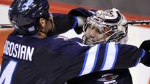 Winnipeg Jets' Zach Bogosian (L) celebrates with goaltender Ondrej Pavelec after defeating the Pittsburgh Penguins during their NHL hockey game in Winnipeg October 17, 2011. REUTERS/Fred Greenslade (Fred Greenslade/Reuters)