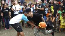 Justin Bieber plays basketball with young survivors of typhoon Haiyan in Tacloban, central Philippines (AP)