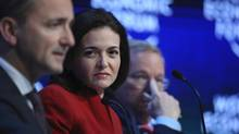 Sheryl Sandberg, chief operating officer of Facebook, centre, and Eric Schmidt, chairman of Google, right, listen as Jim Hagemann Snabe, board member of the World Economic Forum, speaks during a session on Day Two of the World Economic Forum in Davos, Switzerland, on Jan. 22, 2015. (Chris Ratcliffe/Bloomberg)