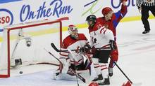 Russia's Nikita Tryamkin (R) celebrates a goal by Russia's Mikhail Grigorenko, not seen, in front of Canada's Mathew Dumba and Canada's goalie Zachary Fucale (L) during the first period of their IIHF World Junior Championship ice hockey game in Malmo, Sweden, January 5, 2014. (ALEXANDER DEMIANCHUK/REUTERS)