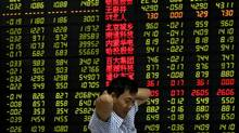 An electronic stock board at a brokerage house in Fuyang city in central China's Anhui province. (AP)