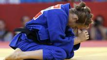 Joliane Melancon of Canada reacts after her match with Sabrina Filzmoser of Austria during the women's 57-kg judo competition at the 2012 Summer Olympics, Monday, July 30, 2012, in London. (Paul Sancya/AP)