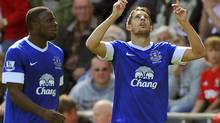 Everton's Kevin Mirallas (R) celebrates scoring a goal with teammate Victor Anichebe during their English Premier League match against Swansea at the Liberty Stadium in Swansea, South Wales September 22, 2012. (REBECCA NADEN/REUTERS)