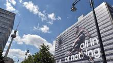 German national soccer player Mesut Ozil appears on an Adidas advertisement on the entire facade of a building in Berlin. Adidas is decrying 'the negative tenor of the public debate around FIFA.' (Jens Kalaene/AP)