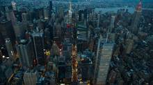 The Empire State Building stands in the Manhattan skyline at dusk in this aerial photograph taken above New York, U.S., on Friday, June 19, 2015. (Craig Warga/Bloomberg)