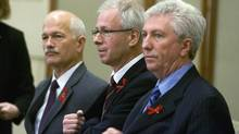 New Democratic Party leader Jack Layton, Liberal leader Stephane Dion, and Bloc Quebecois leader Gilles Duceppe, left to right, shown preparing to sign a coalition deal amongst the three parties to form a government, on Parliament Hill, in Ottawa Monday Dec. 1, 2008. (Tom Hanson/The Canadian Press)