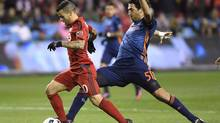 Toronto FC forward Sebastian Giovinco (10) breaks away from New York City FC defender Andoni Iraola (51) for a shot on goal during first half MLS soccer playoff action in Toronto on October 30, 2016. (Frank Gunn/THE CANADIAN PRESS)