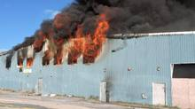 Fire engulfs a building in Shamattawa, Manitoba in this RCMP handout image. (THE CANADIAN PRESS)