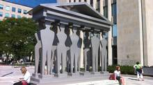 "People relax beside the Edwina Sandys sculpture ""Pillars of Justice"" outside the court house at 361 University Avenue in Toronto in this October, 2012 photo. (Randall Moore/The Globe and Mail)"