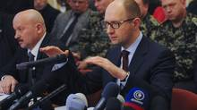 Ukraine's Prime Minister Arseny Yatseniuk, delivers a speech as he attends a meeting in Donetsk on April 11, 2014. (REUTERS)
