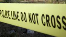 RCMP cordon off a crime scene using police tape. (JOHN LEHMANN/The GLOBE AND MAIL)