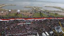 Supporters of Syrian President Bashar al-Assad gather during a rally in the Mediterranean city of Tartous. (SANA/REUTERS)