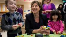 Premier Christy Clark plays with children at a day care in Vancouver on Wednesday. who could not be identified as the daycare refused to provide names for children in attendance, at the Dorothy Lam Children's Centre before an announcement in Vancouver, B.C., on Wednesday February 20, 2013. Clark announced the creation of a provincial early years office, a provincewide network of early years centres, a new child tax benefit and more child-care spaces. DARRYL DYCK FOR THE GLOBE AND MAIL (DARRYL DYCK)
