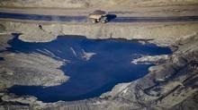 A dump truck drives through an oil sands mine near Fort McMurray. (Ben Nelms/Bloomberg)