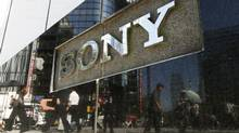 Pedestrians are reflected on a Sony signage in Tokyo June 28, 2011. Sony Corp believes it was targeted by hackers because it tried to protect its intellectual property, CEO Howard Stringer told a shareholders' meeting at which he sidestepped a call for him to step down over the incident. (Toru Hanai/REUTERS)