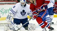 Jonas Gustavsson of the Toronto Maple Leafs gets down to stop the puck on an attempt by Glen Metropolit of the Montreal Canadiens on Tuesday night. (Richard Wolowicz/Richard Wolowicz/Getty Images)
