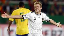 Germany's Andre Schuerle celebrates his goal during their friendly soccer match against Brazil in Stuttgart. (THOMAS BOHLEN/Reuters)