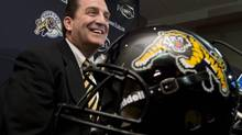 Hamilton Tiger-Cats coach and general manager Kent Austin talks to media at a news conference in Hamilton, Ont., Monday, Dec.17, 2012. Hamilton will pick first in Monday's CFL Draft. (Frank Gunn/THE CANADIAN PRESS)