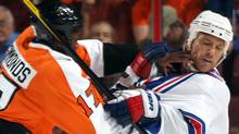 Sean Avery of the New York Rangers is hit by Wayne Simmonds of the Philadelphia Flyers during an NHL preseason game at Wells Fargo Center. (Bruce Bennett/2011 Getty Images)