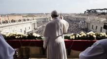 Pope Francis delivers the Urbi et Orbi (to the city and to the world) message at end of the Easter mass, in St. Peter's Square, at the Vatican, Sunday, March 27, 2016. (Dr. Guillermo SIMON-CASTELLVI/AP)