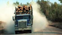 A load of lumber is trucked through the forest surrounding Edmondston, New Brunswick, Canada in this September 2001 photo. International Paper Co., Temple-Inland Inc. and other U.S. lumber companies rejected plans to end a dispute over $7 billion of Canadian lumber imports, a Canadian official said, causing talks to break down. (NORM BETTS/BLOOMBERG NEWS)