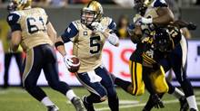 Winnipeg Blue Bombers quarterback Drew Willy scrambles against the Hamilton Tiger-Cats (Nathan Denette/THE CANADIAN PRESS)