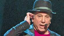 "FILE - In this Oct. 2, 2010 file photo, singer Paul Simon appears on stage at Comedy Central's ""Night Of Too Many Stars: An Overbooked Concert For Autism Education"" at the Beacon Theatre in New York. (AP Photo/Charles Sykes, file) (Charles Sykes/Charles Sykes / AP)"