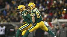Edmonton Eskimos' Adarius Bowman (4) and teammate Nate Coehoorn (R) celebrate Bowman's touchdown against the Ottawa RedBlacks during the second half of the CFL's 103rd Grey Cup championship football game in Winnipeg, Manitoba, November 29, 2015. (MARK BLINCH/REUTERS)