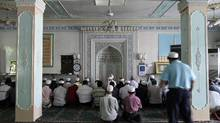 Ethnic Uighurs pray inside a mosque in Urumqi in China's Xinjiang Autonomous Region July 9, 2009. (Nir Elias/REUTERS)