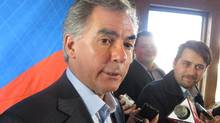 Alberta Premier Jim Prentice tells reporters that his government will balance its budget despite low oil prices, in Banff on Saturday, November 15, 2014. (Bill Graveland/THE CANADIAN PRESS)