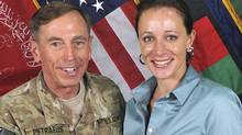 Commander of the International Security Assistance Force/U.S. Forces in Afghanistan General David Petraeus shakes hands with author Paula Broadwell in this ISAF handout photo originally posted July 13, 2011