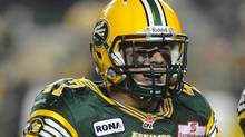 Edmonton Eskimos' JC Sherritt, 47, celebrates getting the CFL record for most tackles in a season against the Calgary Stampeders during second half CFL football action at Commonwealth Stadium in Edmonton on Friday, Nov. 2, 2012. (The Canadian Press)