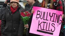 Leah Parsons, left, mother of Rehtaeh Parsons, and her partner Jason Barnes, attend a protest near the Halifax Regional Police headquarters in Halifax on Sunday, April 14, 2013. (Andrew Vaughan/THE CANADIAN PRESS)