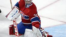 Montreal Canadiens goaltender Carey Price makes a save during third period NHL pre-season action against the Ottawa Senators in Montreal on Thursday, September 26, 2013. The Canadiens won 3-1. (RYAN REMIORZ/THE CANADIAN PRESS)